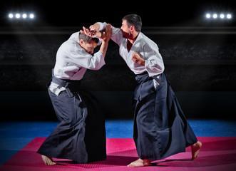 Foto op Aluminium Vechtsport Fight between martial arts fighters at sports hall