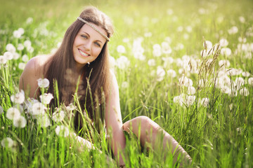 Young woman smiling in a meadow