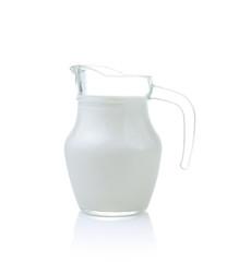 Glass jug of fresh milk isolated on white