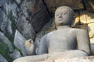 Stone Buddha. Borobudur. Indonesia