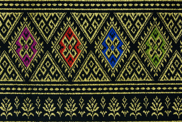 Texture of Thai style golden braid fabric pattern