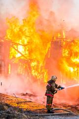 Foto op Textielframe Grandfailure Fireman extinguishes a fire