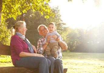 Grandparents with grandson enjoying in park
