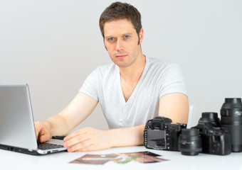Photographer selecting photos on his computer.