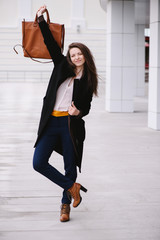 Cheerful fashion woman. Street style