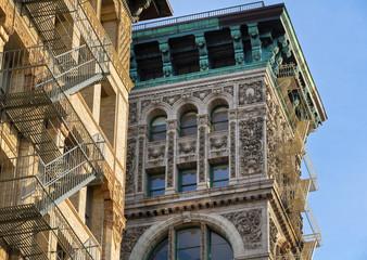 Architectural ornament and copper cornice, building facade, Soho