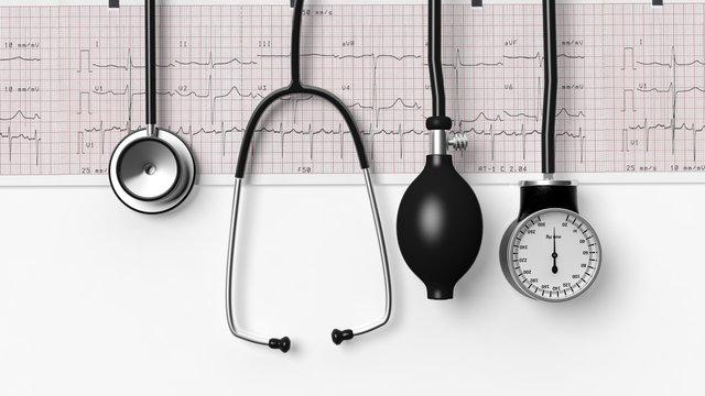 Stethoscope,sphygmomanometer and cardiogram  isolated on white