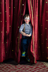 Boy Clown Jumping Through Stage Curtains