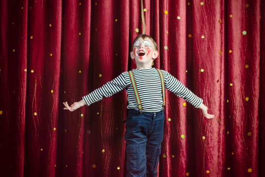 Boy Dressed as Clown Performing on Stage