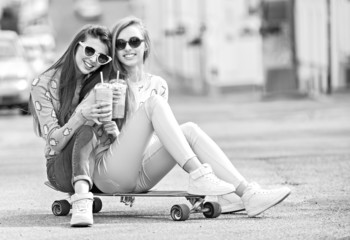 Beautiful young girls hipster girlfriends posing with a