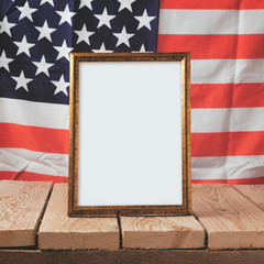 Memorial day background. Picture frame over USA flag
