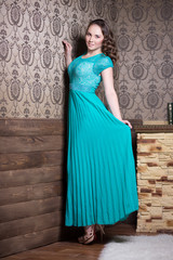 Beautiful woman in turquoise corrugated dress