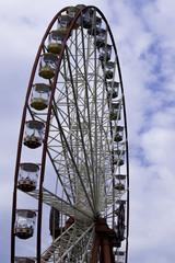 Ferris wheel on the  sky with clouds background. Ukraine. Kharki