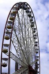 Ferris wheel on the blue sky  background. Ukraine. Kharkiv