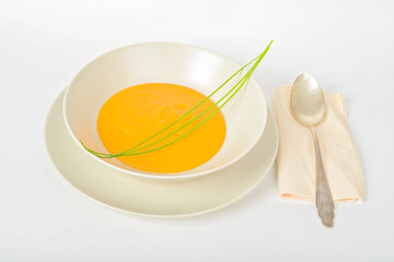 Pumpkin cream soup with spoon