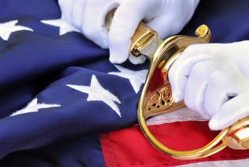 Symbols of a US Marine: white gloves, sabre, flag.