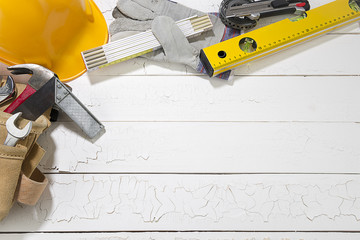 Carpenter Tools on Rough Wood Background