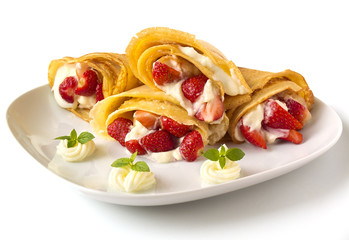 pancakes with strawberry, whipped cream and mint