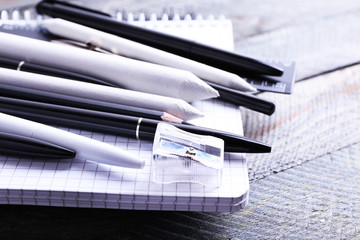 Black and white stationery on wooden table, closeup