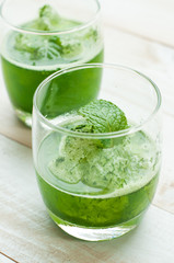 green smoothies on a brown background
