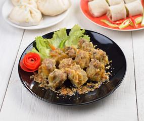Dumplings  for appetizer on black plate