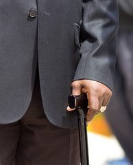 Man in suit with crutch
