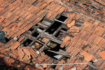 Hole in Damaged Tiled Roof