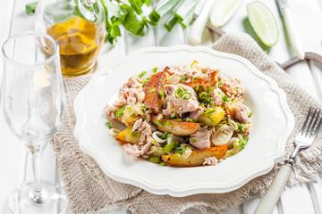 salad of baked potatoes, tuna, green onions and parsley