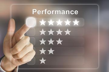 business hand pushing performance on virtual screen