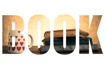 Word BOOK over White mug with many pictured hearts and stack of