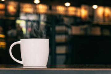White Coffee Mug On Wooden Table In Cafe With Copyspace : With S