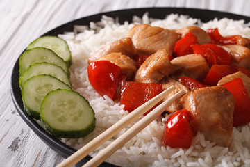 rice with chicken and vegetables close-up. horizontal
