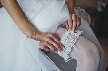 Garter on a foot of the bride 2772.