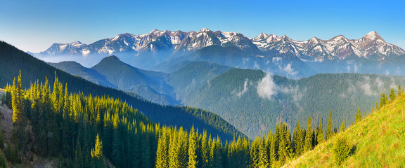 Photo Blinds Mountains Morning view of spring forest and mountains with snow