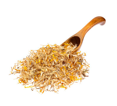 Mountain arnica on the wooden spoon.