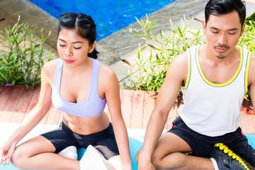 Asian couple in lotus seat yoga pose exercise
