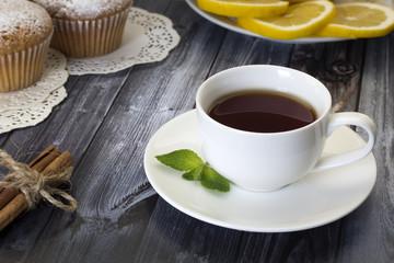 Tea , muffins , lemon and cinnamon