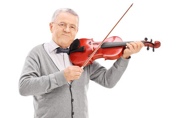 Senior musician playing a violin with a wand