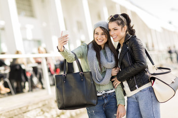 Young women taking selfie