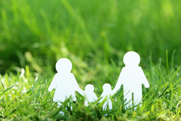 Cutout family over green grass background