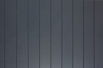 A natural dark gray wood wall texture
