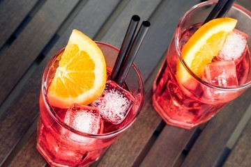 Fototapete - close-up of view of glasses of spritz aperitif red cocktail