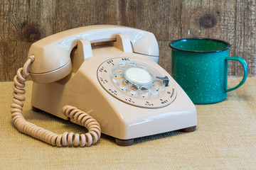 Rotary telephone with a coffee cup