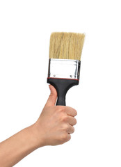 Woman hand with paint brush with plastic wooden handle