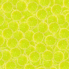 Abstract background with slices of fresh limes. Seamless pattern