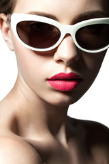 Fashion model close up in sunglasses on white background
