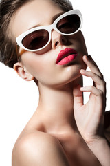 Fashion woman in retro sunglasses on white background isolated