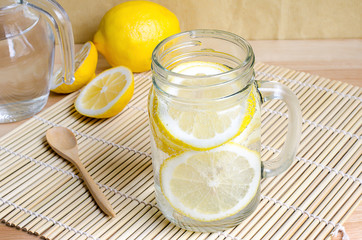Soda with lemon in jar on wooden table