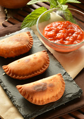 homemade tuna patty with tomato sauce