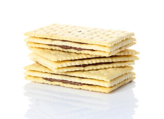 Sandwich biscuits with chocolate on white background